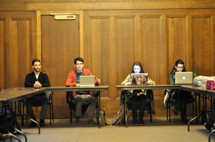 SGA President Joseph Knotts (center) and Vice President Daly Tongren (third), along with Treasurer, Svjeltana Grbic (right) and student trustee, Chris Mich conduct the weekly meeting.