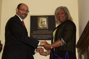 Photo Caption: National ASALH president Daryl Michael Scott, and original chicago branch member, Darlene Clark Hine stand by the unveiled plaque Photo Credit: Quinton R. Arthur