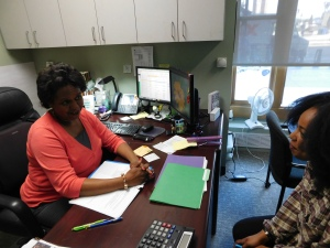CAPTION: Pamela Thompson-Hill, associate director of the new First-Generation Student Support Services program talks with a student. Photo by Megan Schuller