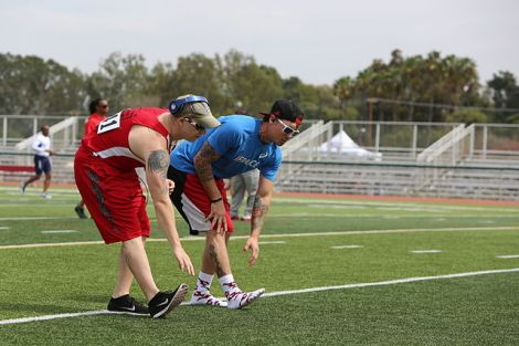 Athletes stretch before a sporting event. Photo courtesy of Lance Cpl. John Baker and Wikimedia Commons.