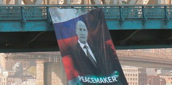 putin-banner-courtesy-of-business-insider
